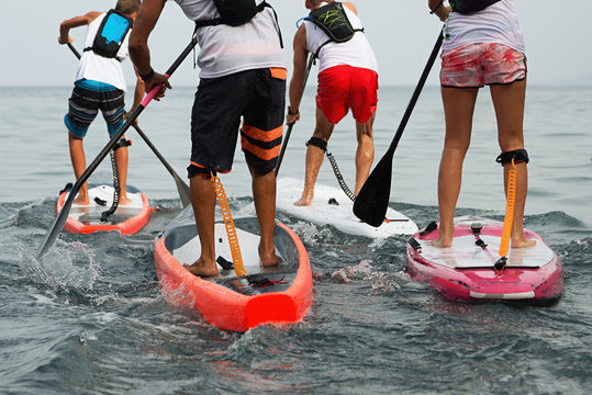 Stand up paddle group on the sea