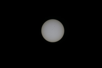 sun and sunspots seen through solar filter