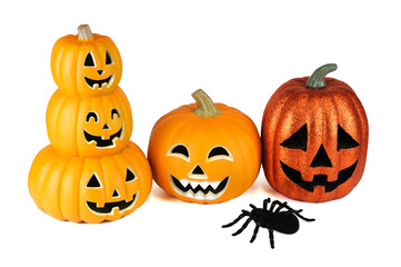 Halloween pumpkin lantern and spider isolated on white background