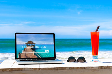 Search hotels website on computer screen, online booking concept
