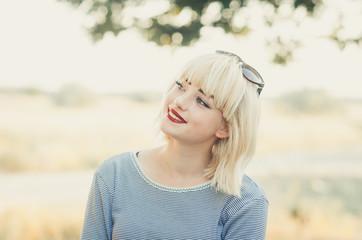 Closeup portrait of young beautiful blonde