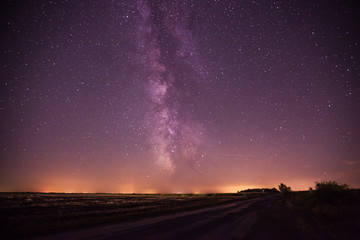 Night road at countryside under the milky way.