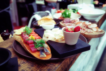 Platter of food on restaurant counter, toned