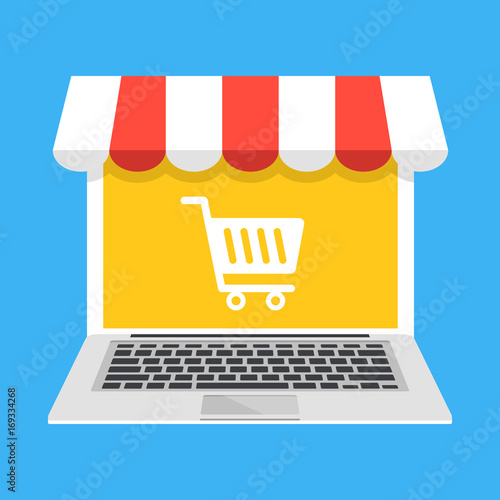 4dcae15c01f Laptop with white shopping cart icon on screen and storefront awning.  E-commerce