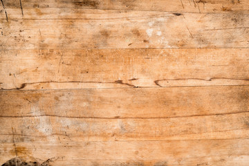 Old, scratched wooden board for background, wood texture