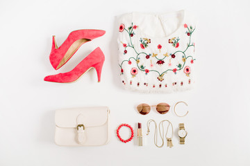 Woman styled fashion clothes and accessories collage on white background. Flat lay, top view.