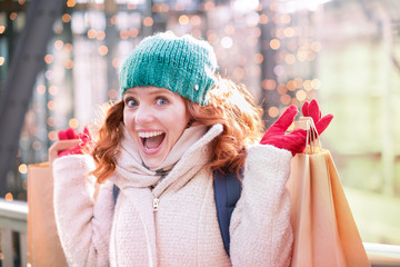 young smiling christmas shopper