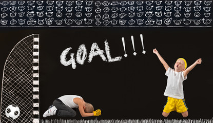 Two brothers play football.A goal in the opponent.Drawings in chalk on the wall.