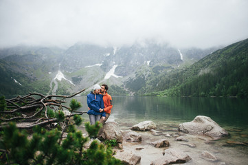 Traveler couple in love enjoying the mountains