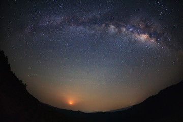 Milky Way over mountain with moon light at Phu Hin Rong Kla National Park,Phitsanulok Thailand