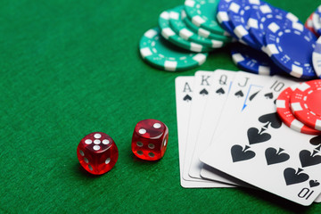 Casino red dice, play cards as roial flush