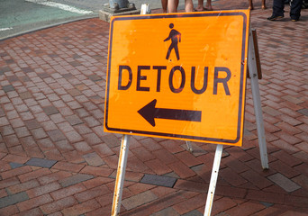 detour sign on the pedestrian sidewalk