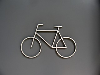 Bicycle storage room sign on a grey metal door Wall mural