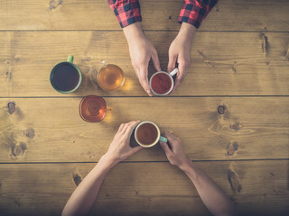 Over view of man and woman trying different teas