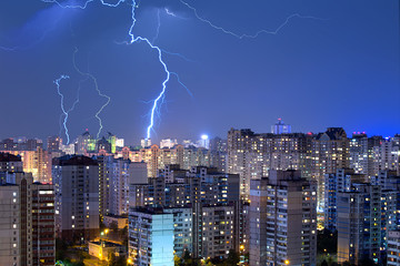 Large lightning bolts above the city.