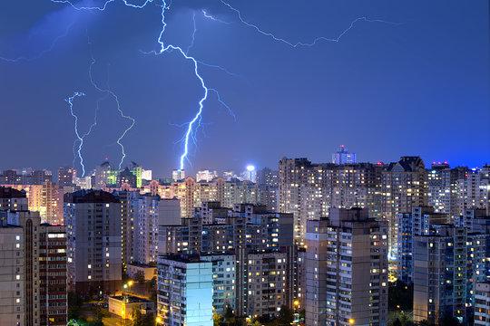 Large lightning bolts above the city.