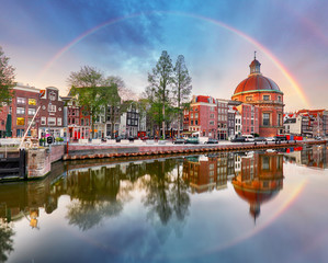 Spoed Foto op Canvas Amsterdam Rainbow over Amsterdam church Koepelkerk, Netherlands