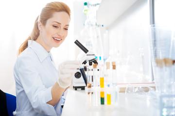 Positive delighted female taking test tube