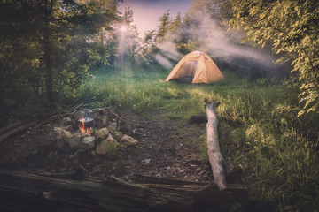 Travel tent in a light of sunrise. Instagram stylization Wall mural