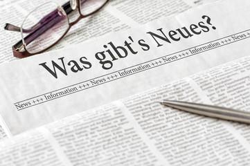 Zeitung mit der Überschrift Was gibts Neues