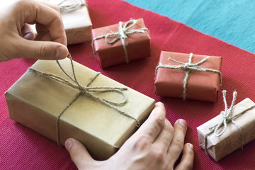 The man wraps gifts