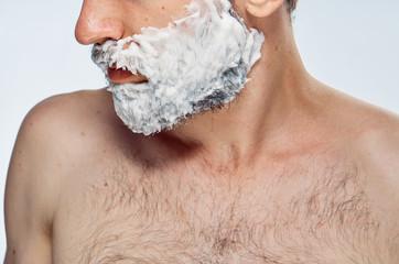 Man in shaving foam, portrait, close-up