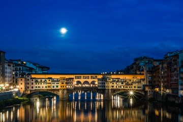 Wall Murals Florence Ponte Vecchio over Arno river at night in Florence, Italy.