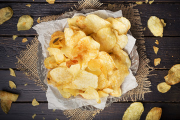 Bowl of potato chips on a rustic table