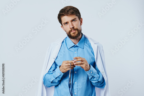 Male doctor in medical dressing gown\