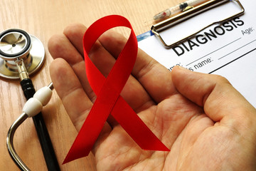 Obraz Symbol of HIV/AIDS. Red awareness ribbon. - fototapety do salonu