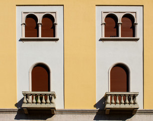 Vintage style windows on a building facade (front view)