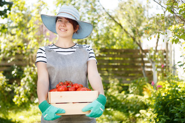 Woman holding box with tomatoes