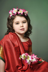 Little girl in red indian sari and flowers