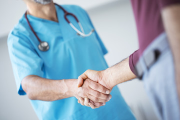Doctor shakes hands with a patient