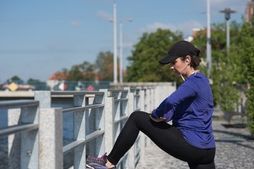 Woman performing stretching exercise on bridge