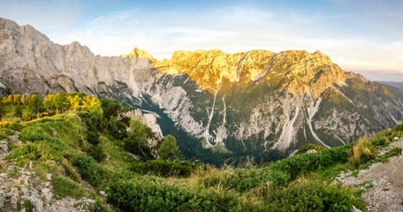 Wall Mural - Great panoramic view to mountains and valley in sunset light with alpenglow.