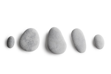 Grey pebbles on white background Wall mural