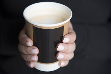 A cup of coffee in hands
