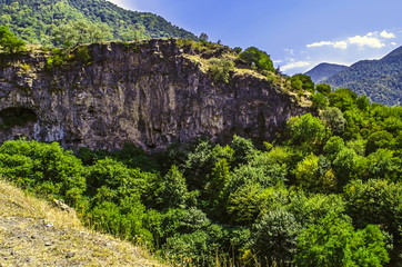 Road leading to the monastery of Haghpat in mountains with medieval caves in the rocks