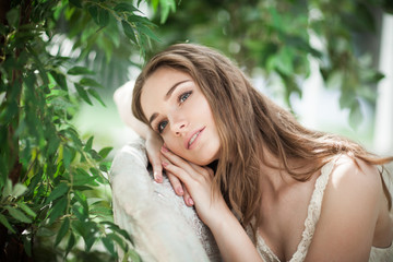 Portrait of Beautiful Woman Fashion Model Relaxing in Green Leaves