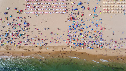 Aerial. Abstract photo of the sea, beach and vacationers from the sky.