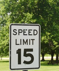 The white and black speed limit sign on a close view.