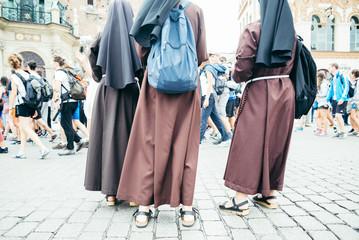 nun feet in crowd