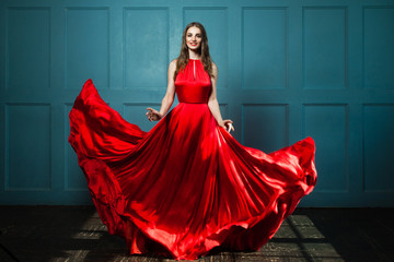 Glamorous Woman in Fashionable Red Dress. Beautiful Fashion Model, Full Portrait