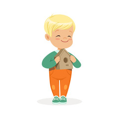 Cute smiling little boy standing and holding birdhouse cartoon vector Illustration