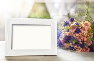 Empty frame mockup and flowers
