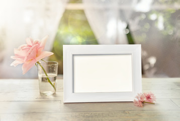 Frame mockup with flower in glass