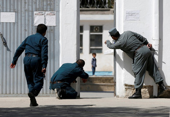 The Wider Image: Kabul mosque attack: four-year-old called to safety