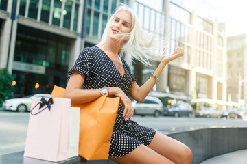 Woman with purchases in dress