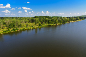 A beautiful river landscape and trees in a dead radioactive zone. Consequences of the Chernobyl nuclear disaster, August 2017.